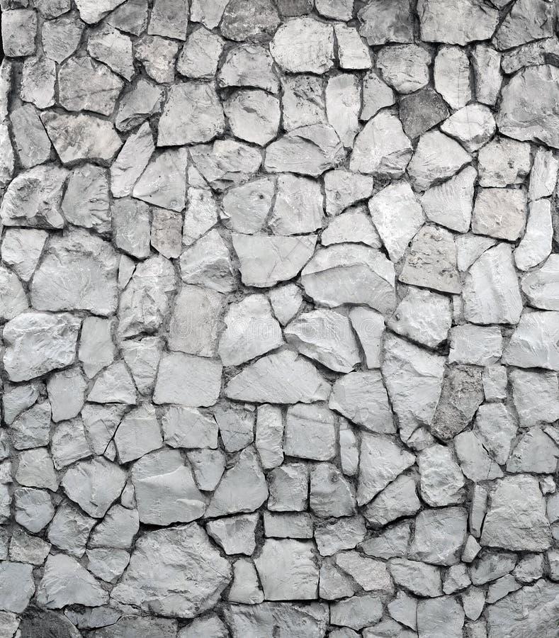 Grijze rotsmuur stock afbeeldingen