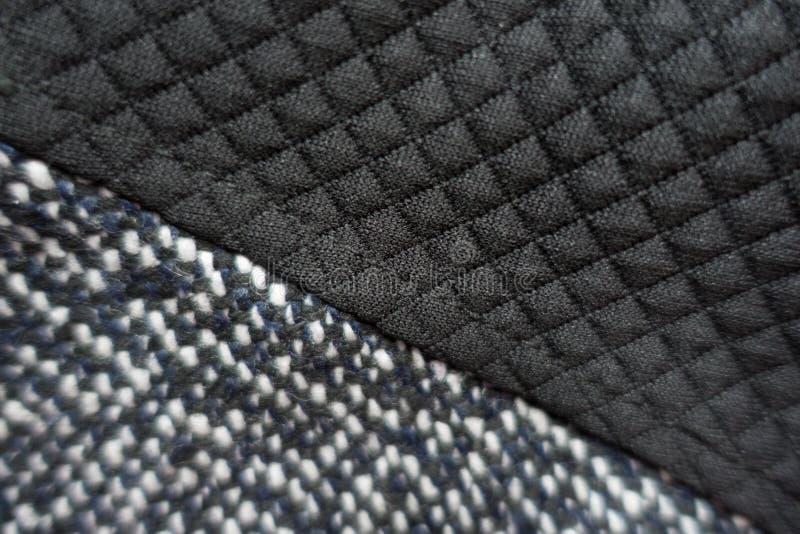 Grijze samen genaaide tweed en zwarte polyester stock afbeelding
