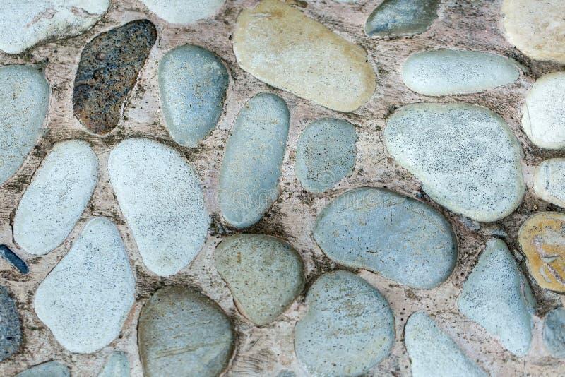Grijze steenstraatstenen van ronde stenen Grijze achtergrond royalty-vrije stock afbeelding