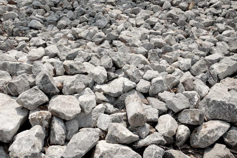 Grijze stenen en rotsentextuurachtergrond stock foto