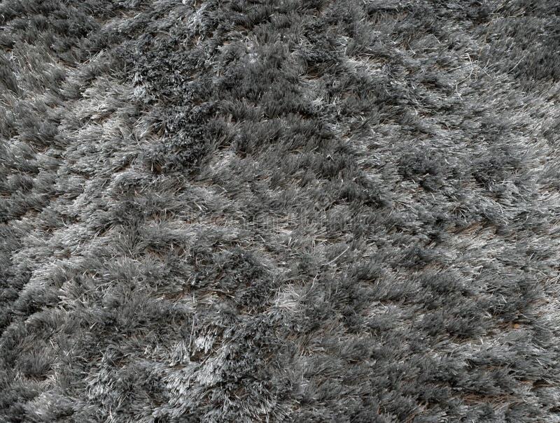 Grijze tapijt dichte omhooggaand als achtergrond stock fotografie