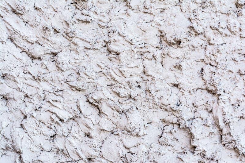 Grijze textuur van een concrete muur, laag van decoratief pleister, abstracte achtergrond stock afbeeldingen