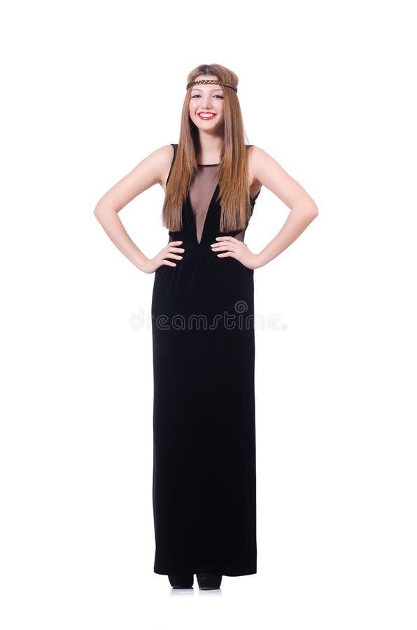 Gril joven del pelirrojo en el vestido largo negro aislado encendido fotografía de archivo