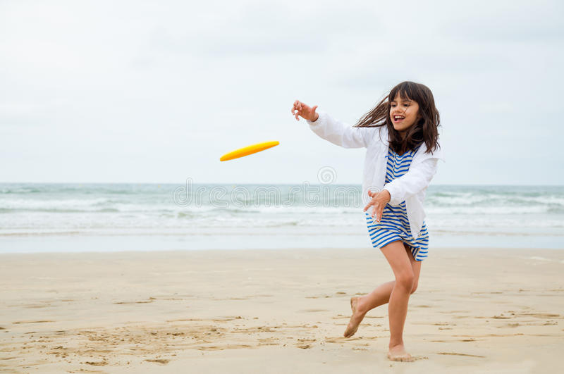 Gril playing frisbee royalty free stock image
