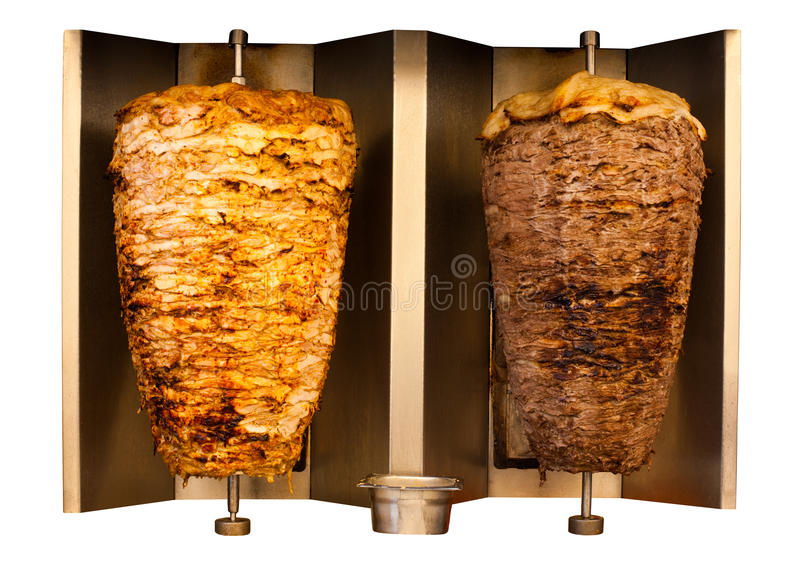 Grill Chicken Lamb Mutton Shawerma Meat Machine. Delicious skewered fast food chicken and lamb mutton kebab, shawarma meat cooking and turning side by side on royalty free stock images