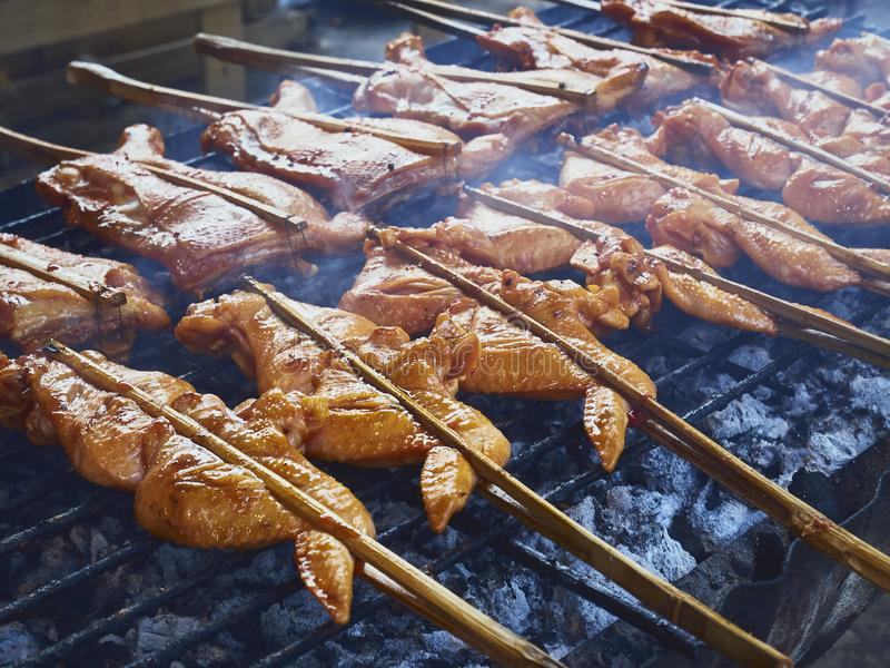 Grill Chicken wing on grill plate Street food stall royalty free stock image