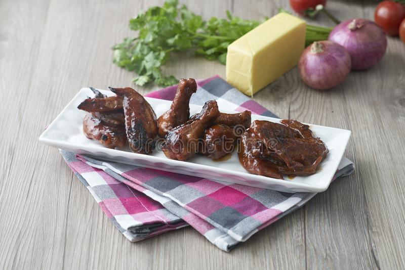 Grill chicken wings. A plate of grill chicken wings royalty free stock photo