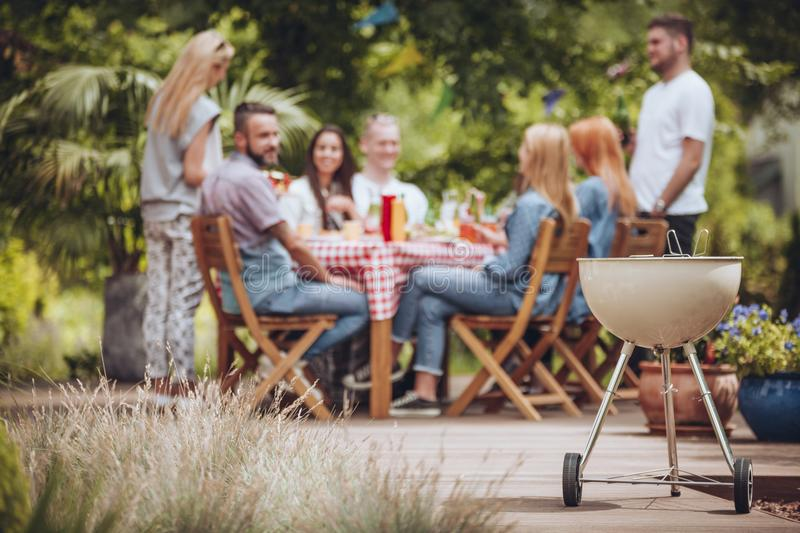 Grill in the garden. Friends meeting during barbecue party stock photography