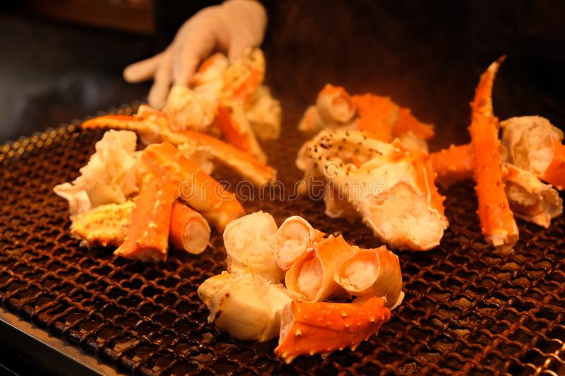 Grill Giant Crabs on roaster popular seafood grill at Tsukiji fish market, Tokyo - Japan royalty free stock images