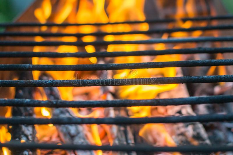 Grill grate fire. Grill grill grill fire picnic close - up flame stock images
