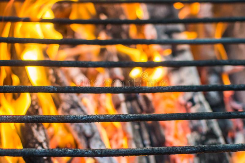 Grill grate fire. Grill grill grill fire picnic close - up flame stock photo