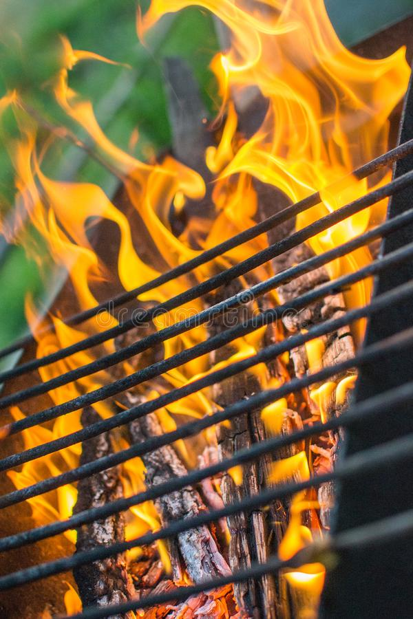 Grill grate fire. Grill grill grill fire picnic close - up flame royalty free stock photography