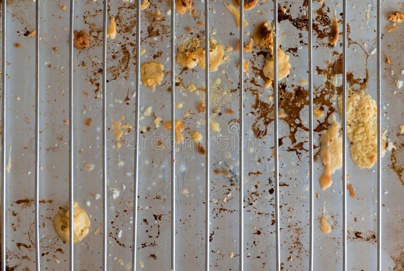 Grill met de residu's van kaas stock afbeelding