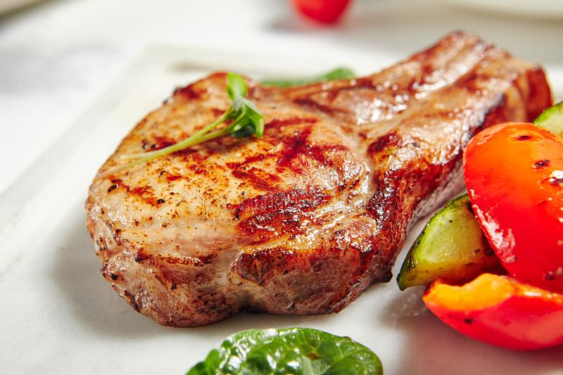 Grill Pork Chops. Grill Restaurant Meat Menu - Grill Pork Chops with Vegetables royalty free stock photos