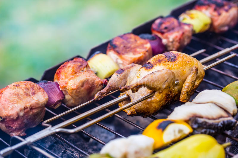 Grill. Quail on the grill. Grill pork meat. Grill burgers. Grill vegetables. Grill skewer stock images
