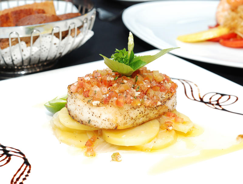 Grill Sea Bass. With Lemon Sauce, selective focus royalty free stock photo