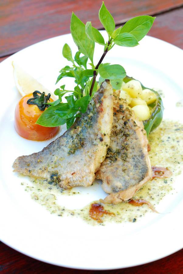 Grill Sea bass. With Pepper Sauce royalty free stock photography