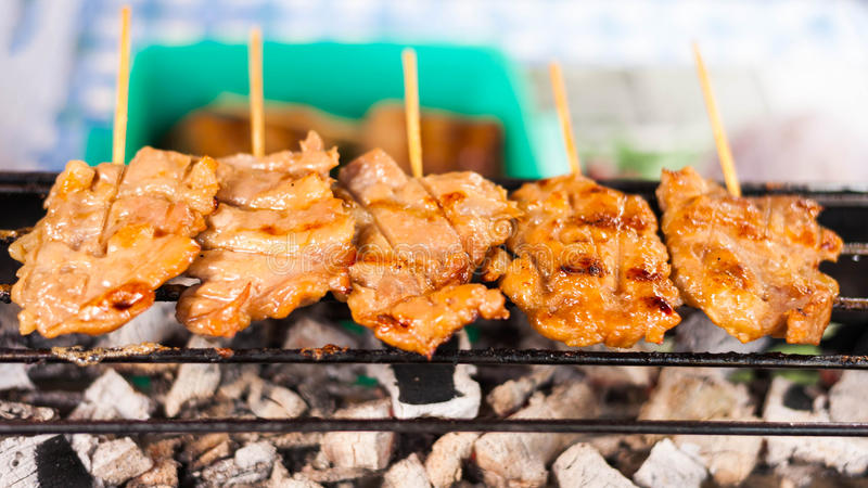 Grill spit. BBQ pig Cooking on Grill royalty free stock photos
