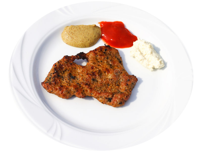 Grill steak. Barbecue plate: beef steak with spices, isolated stock photo