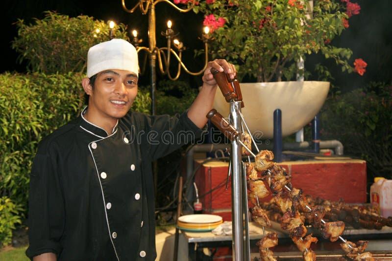 grilla szef kuchni gość restauracji zdjęcie stock