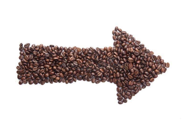 Grillade kaffebönor i pilform arkivfoton