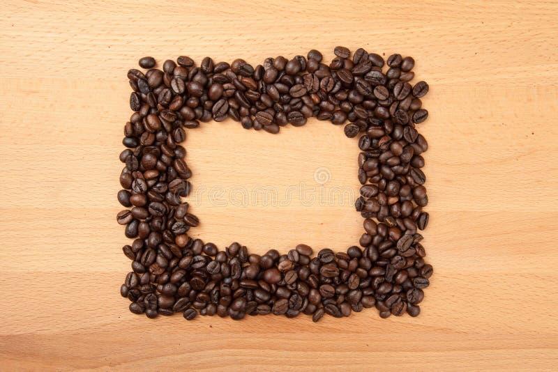 Grillade kaffebönor i rektangulär form fotografering för bildbyråer