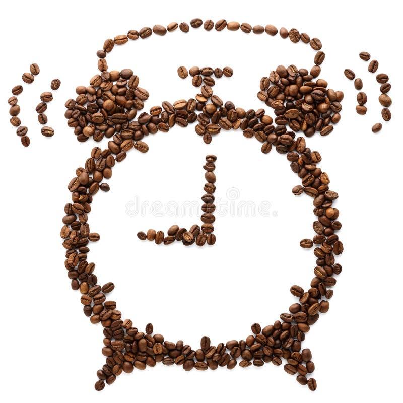 Grillade kaffeb?nor som formas som att ringa ringklockan royaltyfri foto