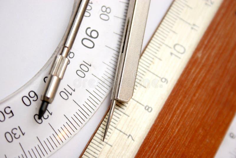 Grille de tabulation et compas photographie stock