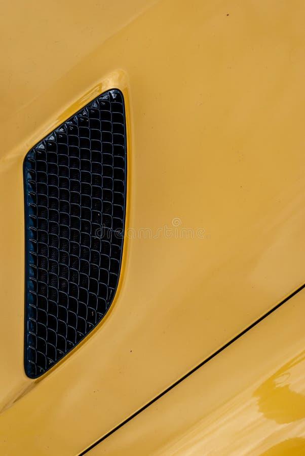 Grille noire d'entrée d'air de voiture jaune de turbo de sport image stock