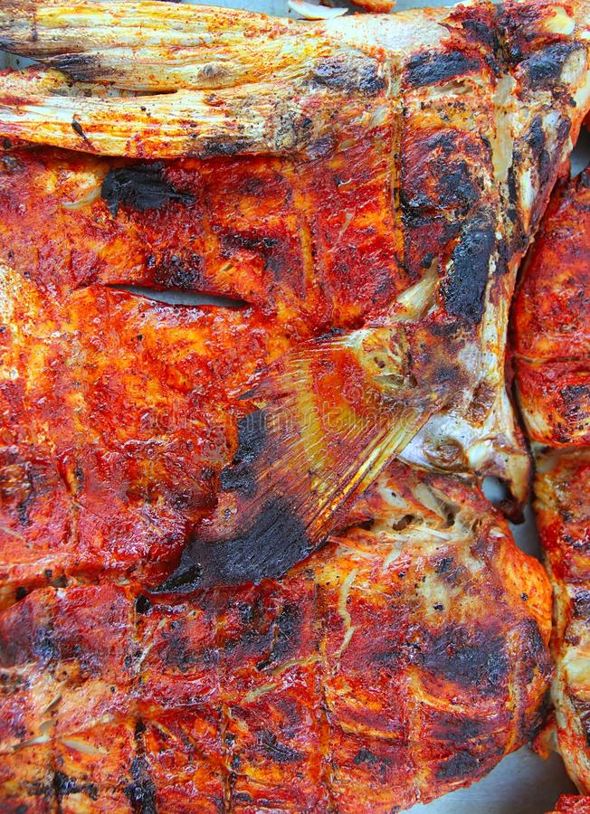 Grilled amberjack fish achiote Mayan sauce stock photo