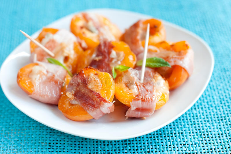 Grilled apricots with bacon royalty free stock photo