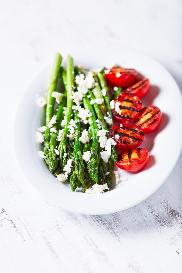 Grilled Asparagus and Cherry Tomatoes with Feta Cheese stock photo