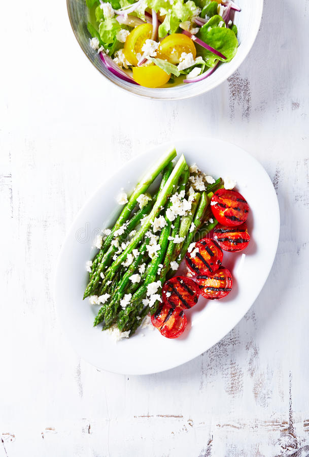 Grilled Asparagus and Cherry Tomatoes with Feta stock photography