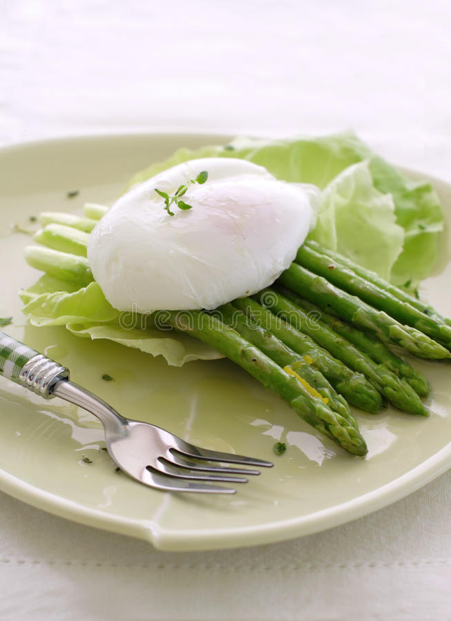 Grilled asparagus with poached egg stock photography