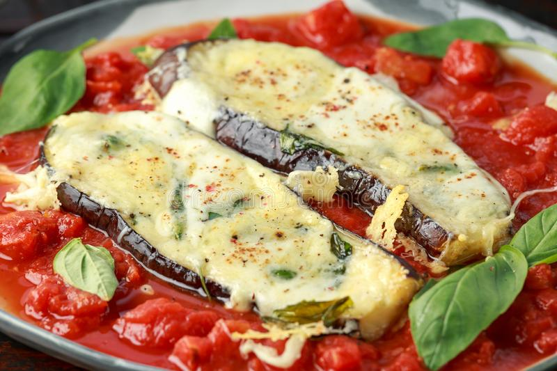 Grilled aubergine, eggplant topped with parmesan cheese crust on crashed tomatoes. Vegetarian pizza version.  royalty free stock photos