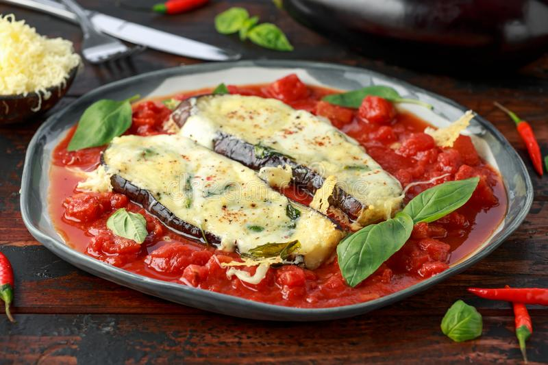 Grilled aubergine, eggplant topped with parmesan cheese crust on crashed tomatoes. Vegetarian pizza version.  stock image