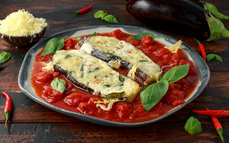 Grilled aubergine, eggplant topped with parmesan cheese crust on crashed tomatoes. Vegetarian pizza version.  royalty free stock images