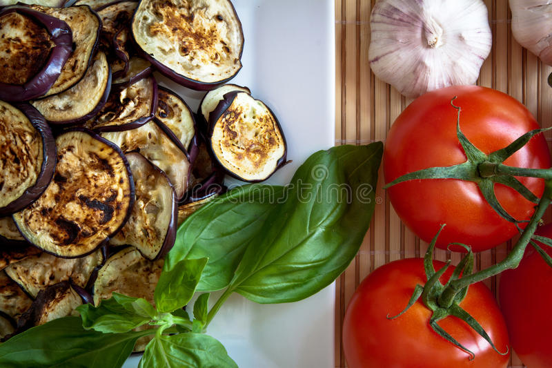 Grilled aubergines with basil, detail stock image