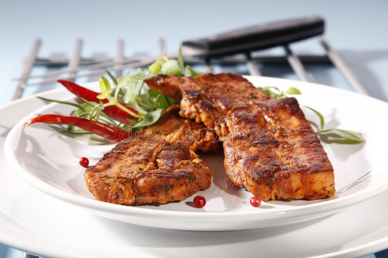 Grilled bacon. With spiece and red pepper stock photography