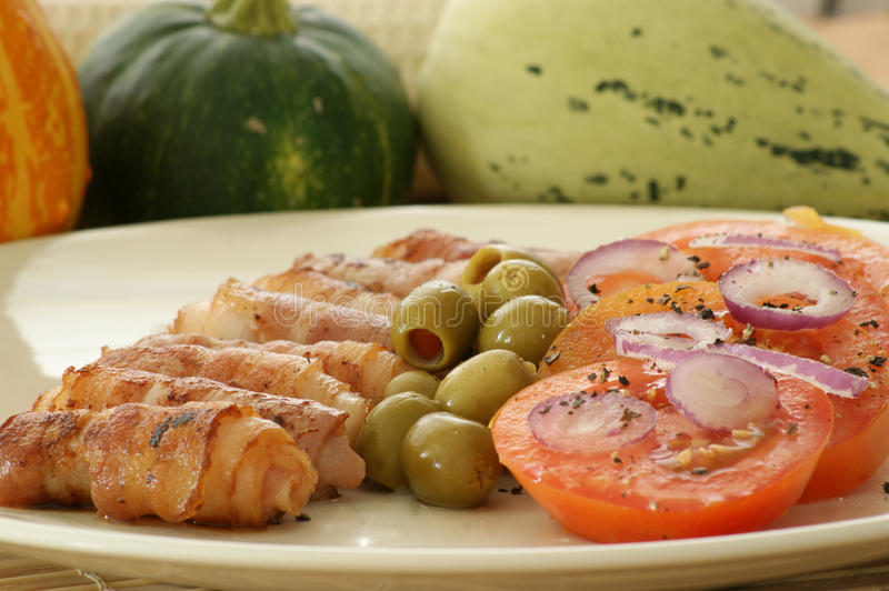 Download Grilled Bacon With Tomato And Olive Salad Royalty Free Stock Image - Image: 10851566