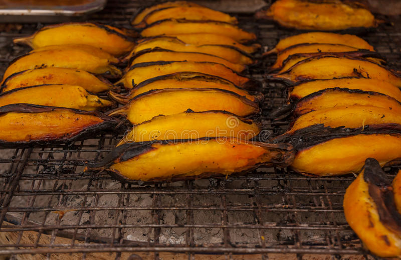 Grilled bananas on the grill. stock photos