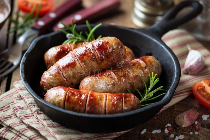 Grilled banges or sausages in a pan stock image