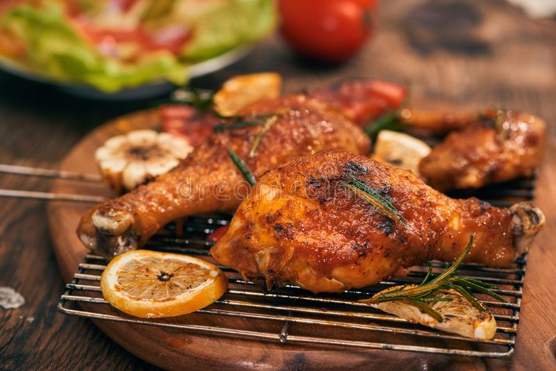 Grilled bbq chicken with fresh herbs and tomatoes.  royalty free stock photo