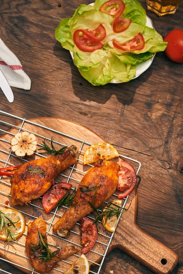Grilled bbq chicken with fresh herbs and tomatoes.  stock images