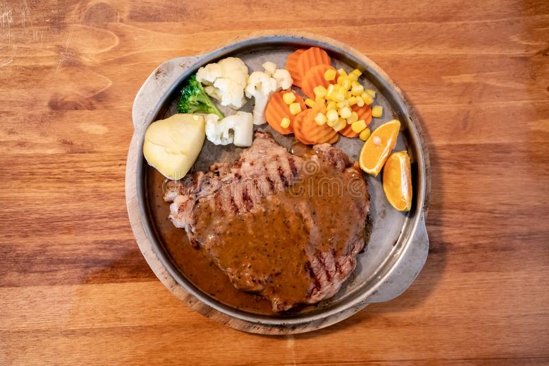 Grilled beef meat steak with oranges and vegetables stock photo