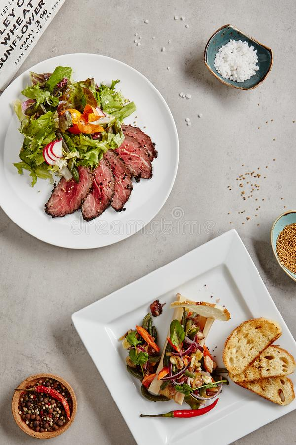 Roast Beef Salad with Green Mix and Bone Marrow with Vegetables stock photography