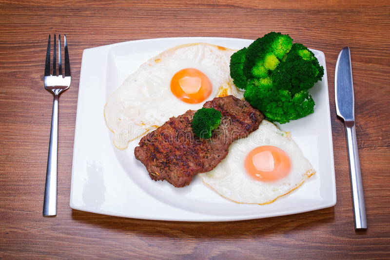 Grilled Beef Steak With Eggs. Stock Photography