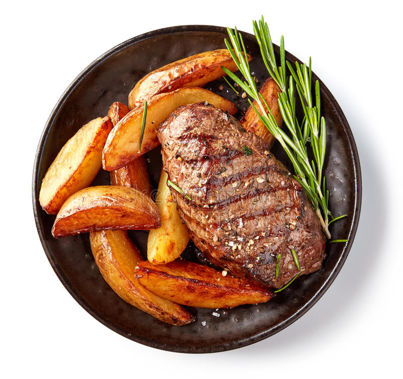 Grilled beef steak and potatoes royalty free stock photography