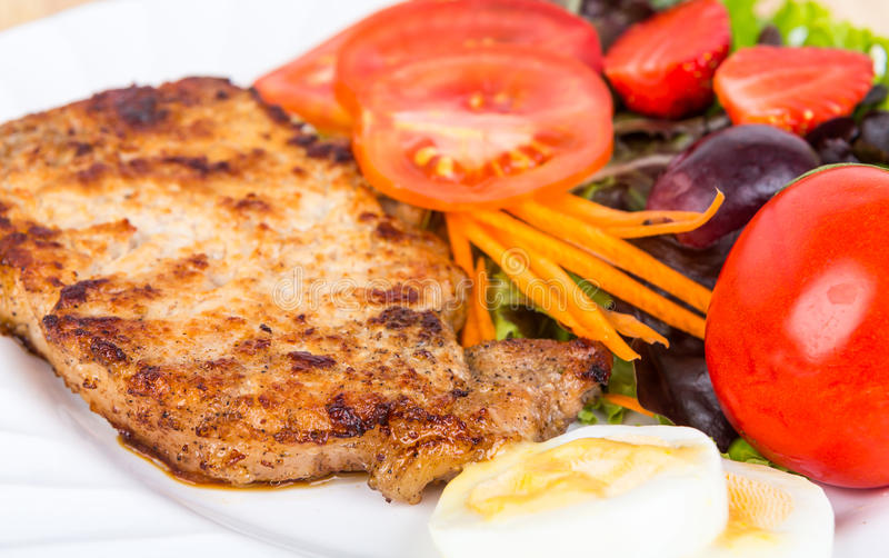 Grilled beef steak with salad delicious royalty free stock image
