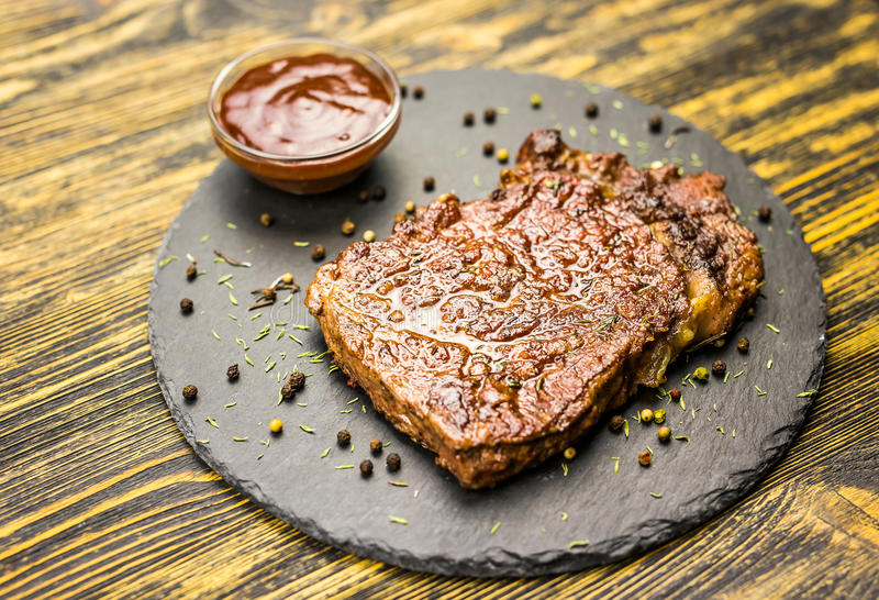 Grilled beef steak with sauce stock photos